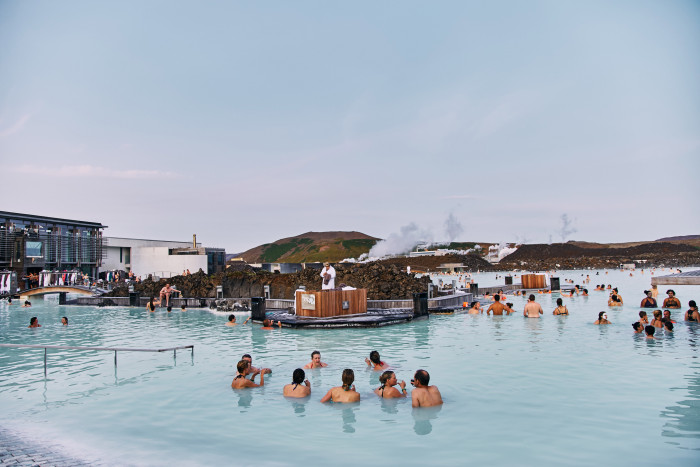 Reykjavik, Iceland - August 21, 2017:The Blue Lagoon geothermal spa is one of the most visited attractions in Iceland. People relax in the blue lagoon.